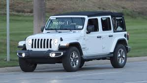 white and teal jeep entire 2018 jeep wrangler lineup photographed on road 40 images