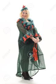 woman in the christmas tree costume on white background stock