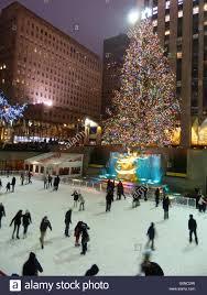 new york city rockefeller center ice skating ring with christmas