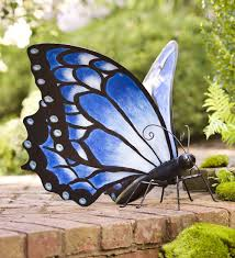 large blue metal butterfly in garden statues butterflies