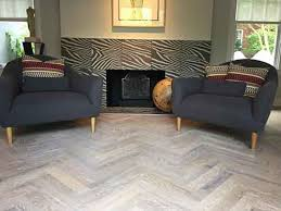 custom herringbone pattern and white stained hardwood in annapolis