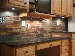 porcelain tile backsplash kitchen stone river rock metal
