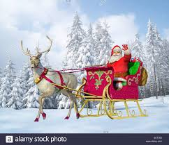 santa claus driving a sleigh with reindeer on a snowy ground
