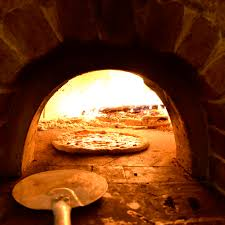 pizza making in our pizza oven after orange county