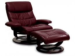 maroon leather chair with low arm rest also stool completed with