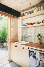 outbuilding of the week garage turned studio apartment gardenista above many of the elements inside the studio apartment were repurposed or salvaged everything including the kitchen sink see 10 easy pieces leather