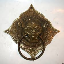 pair of asian metal drawer pulls or door knockers with fantasy
