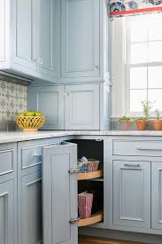 cornflower blue cabinets with glass knobs transitional kitchen