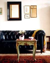 Black Tufted Sofa by Bold Black Tufted Chesterfield Sofa Team Up With Small Vintage