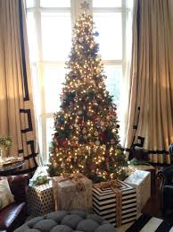 creating a faux gift fence around your christmas tree to help keep