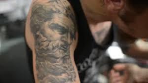 Forearm Wolf - artist master of wolf on forearm studio stock