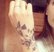 tattoo on top of wrist caitlin stasey shows off new rose and swallow tattoo on her wrist