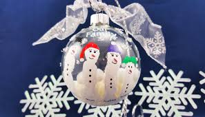 a handmade craft finger paint snowman family ornaments