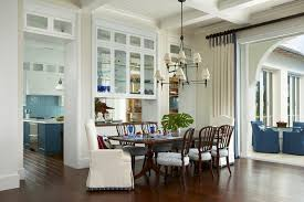 Archway Pass Through Dining Room Tropical With Dark Wood Floor - Tropical dining room sets counter height
