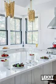 modern kitchen pendant lighting ideas for an all in industrial design like this space there s no better choice than these warehouse style lights a polished nickel finish makes them feel