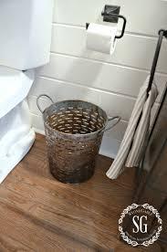 bathroom gorgeous impressive wooden floor and iron wastebaskets