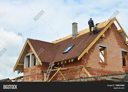 roofing construction and building new brick house with modular