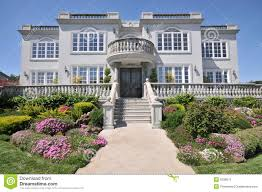 majestic two story mansion with shrubs in yard stock image image