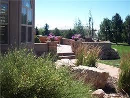 terraced backyard design with radius walls landscaping network