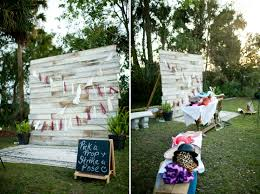 wedding photo booth ideas photo booth backdrop with wood and green elements details