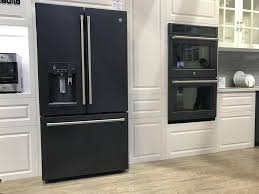 gray kitchen cabinets with black stainless steel appliances how to choose the right appliance finish cnet