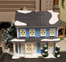 a vacation table setting with department 56 lit houses