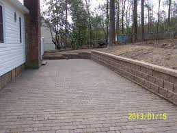 Paver Patio With Retaining Wall by Deck Builder Patio Retaining Wall Paver Installer Trex Decking