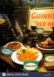 outside pub window stock photos outside pub window stock images plastic models of food in a window display outside an irish pub stock image