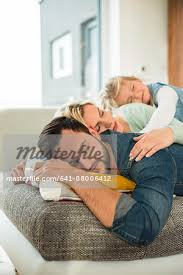 where to buy free hug sofa family lying on couch on top of each other with closed eyes stock
