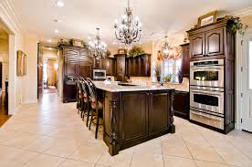 Chandelier Over Kitchen Island by Celtic Custom Homes Fine European Qualtiy Homes