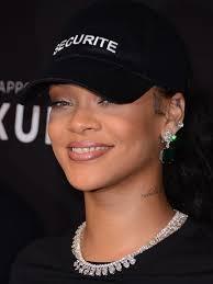 rihanna earrings rihanna glams up casual with diamond and emerald jewelry