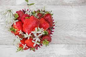 s day strawberries basket heart shaped with fresh strawberries and white flowers as a