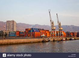 large cranes and shipping containers inside a shipyard on the