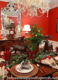 dining room table setting for christmas table setting tablescape with plaid plates and a natural greenery