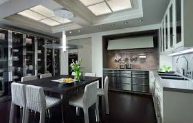 Kitchen Cabinet Table Stainless Steel Kitchen Cabinet With Black Table And Hanging Lamp