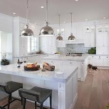 kitchens with two islands dual islands with gray counter stools transitional kitchen