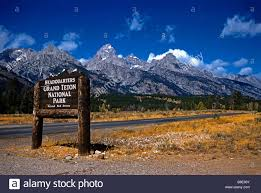 Wyoming scenery images Wooden sign and mountain scenery grand teton national park jpg