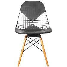 First Dibs Home Decor Eames Wire Chair Pad Wooden Legs 1st Dibs Film And Furniture