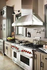 best 25 pot filler faucet ideas only on pinterest pot filler a small niche behind the stove is a great place for oils and spices and