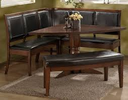 kitchen dining table with banquette and bench with leather