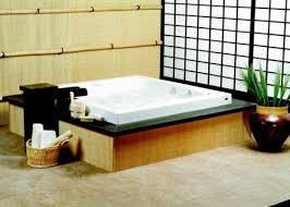 japanese bathroom design small space stone bathtun on green grass