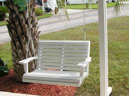 white wood striped porch swing with back and double arms completed