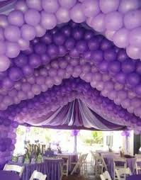 amazing purple balloons decorations draping and tablescape
