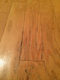 flooring how can i repair the damage to this wood floor home