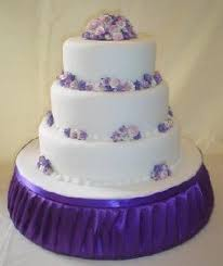 abbeydale wedding cake in white with small purple flowers