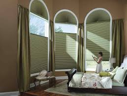 with vertical blinds red fabric over valance and curtains patio