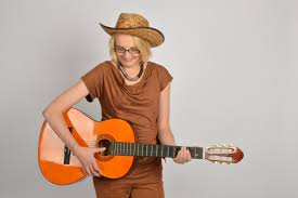 happy woman with guitar country style free image