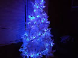 blue white christmas lights christmas tree with white lights and red decorations inspirational