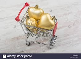 decorations in a shopping cart on white wooden