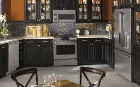 black kitchen appliances with grey cabinets stainless steel bar